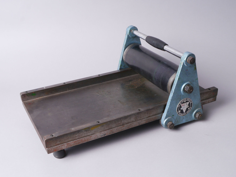 Kleine manuele proefpers van het merk Linotype